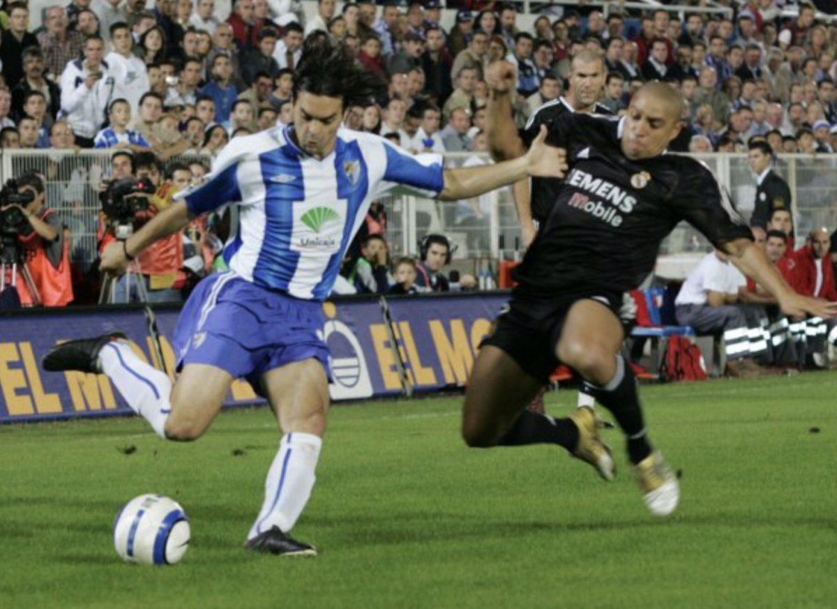 Manu Sanchez (Malaga CF) attacking Roberto Carlos (Real Madrid)